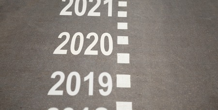 2019, 2020, 2021 numbers and road markings on empty road. 2020 year is coming concept