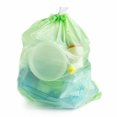 Plastic garbage bag full of plastic trash on white background, isolated