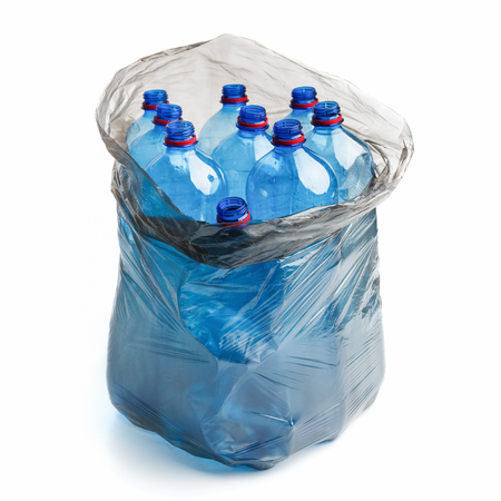 Garbage bag full of plastic bottles isolated on white background. Plastic pollution concept