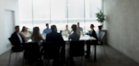 Business people having meeting or conference in office, blurred, panorama