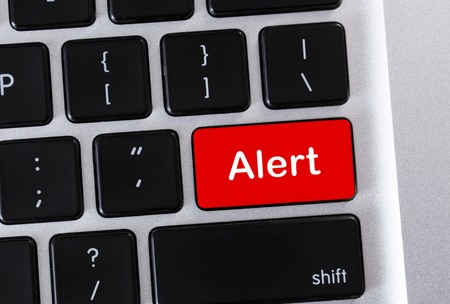 Alarm concept. Alert word on red computer keyboard button