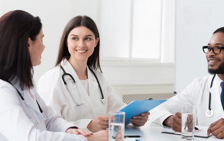 Medical Team Interacting At Meeting In Conference Room, Discussing Diagnosis