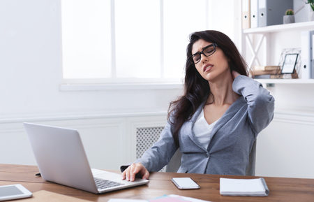 Tired Businesswoman Suffering From Neck Pain After Sedentary Computer Work