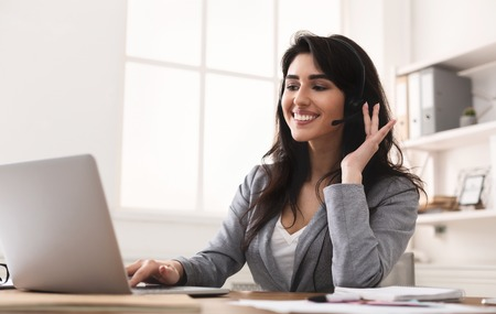 Work In Callcenter. Female Secretary With Headset Doing Customer Service Stock Photo