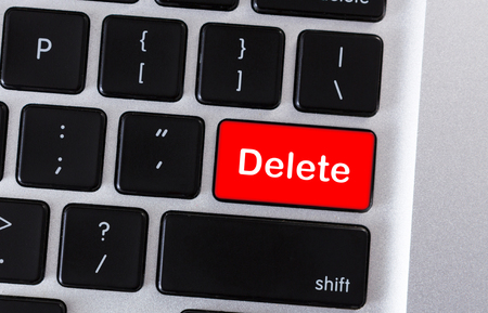 Computer keyboard with word Delete on red button