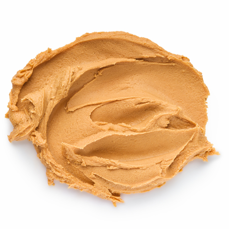 Smear of peanut butter isolated on white background