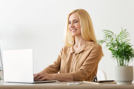 Executive Financial Woman Working On Laptop In Office, Making Reports
