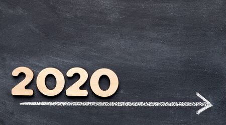 2020 concept on time line with arrow on chalk background, panorama, free space
