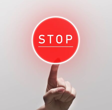 Woman Finger Pushing red round Stop sign, copy space