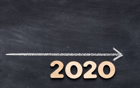 2020 concept. Time line handwriting with chalk on chalk board background, panorama, copy space