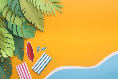 Summer background of tropical island with monstera leaves and beach near the sea, paper photo, free space