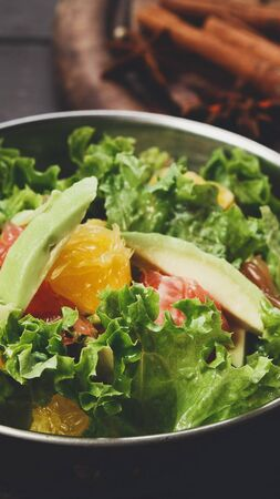 Close up of fresh fruits and vegetables salad in copper bowl, vertical panorama Reklamní fotografie