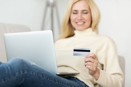 Online Shopping. Middle-Aged Woman Using Credit Card For Paying Stock Photo