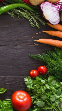 Frame of fresh organic vegetables on rustic wood background, vertical panorama Stok Fotoğraf