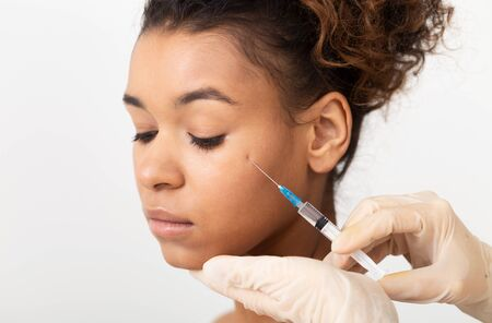 Plastic Surgery Concept. Woman Getting Cosmetic Injection Near Eyes Stock Photo