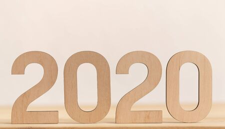 2020 concept. Close up of Big wooden numbers on light background, panorama, copy space