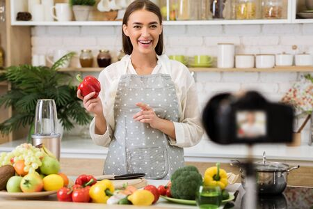 Food blogger working on new video, explaining how to cook dish, recording video