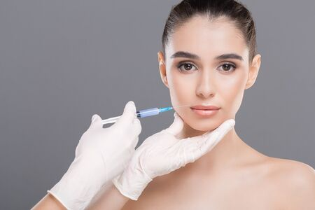 Injections of beauty under skin. Facial Rejuvenation for women, empty space