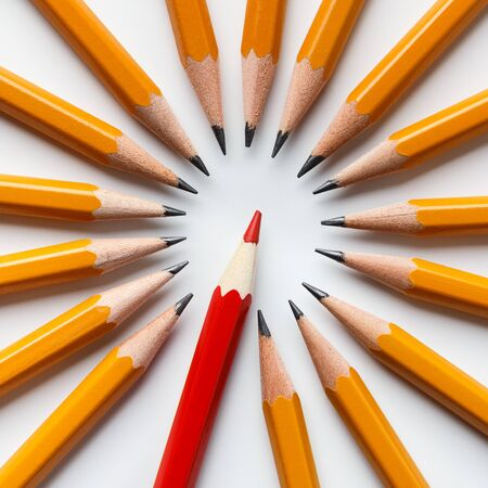 Winner, exclusivity and financial success. One red pencil among group of classic yellow ones Banco de Imagens