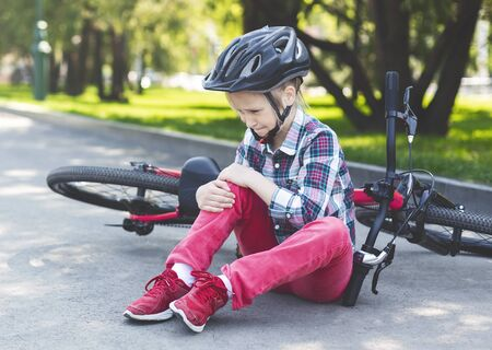 Girl Is Crying And Sitting Next To Her Bicycle, fell down from bike, got hurt