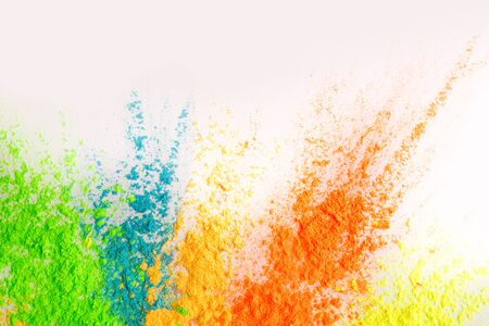 Spring Indian festval. Colorful explosion of holi dust on white background, copy space