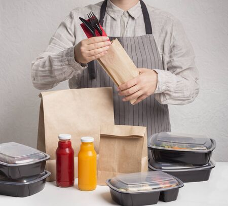Man collecting order of dayily heathy ration of food in boxes for delivering