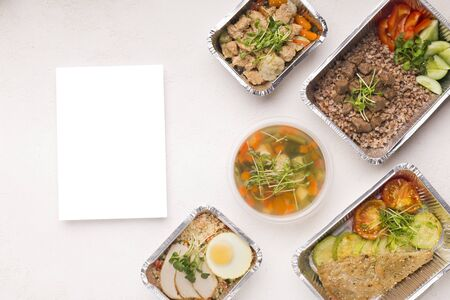 Lunch time. Set of healthy food in foil boxes for delivery with copy space on white background Standard-Bild