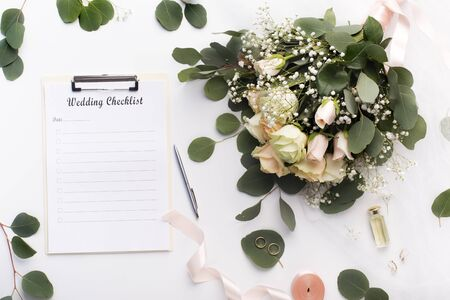 Wedding checklist. Flowers and note with blank space for writing on white background