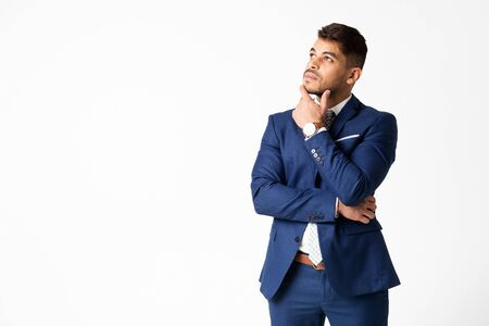 Strategic Thinking. Pensive Arab Businessman Touching His Chin Posing On White Background In Studio. Free Space