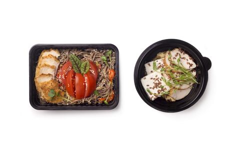 Healthy food for diet nutrition for lunch in black boxes to go on white background, copy space 版權商用圖片