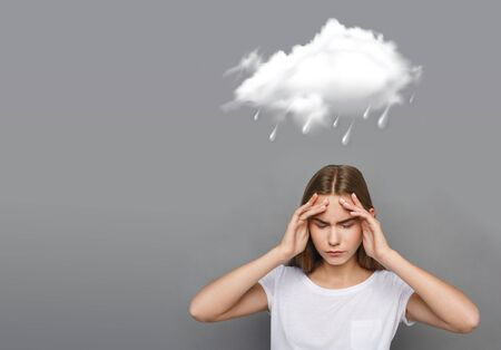 Rainy weather icon and girl with terrible headache on gray background, copy space