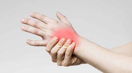 Pain in palm. Man massaging sore zone on palm, closeup