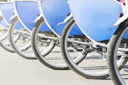 Rent-a-bike services. Bicycles ready for renting, free space