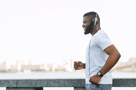 Young Afro Guy Enjoying Running And Listening To Music Stock Photo