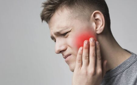Tooth sensitivity. Man suffering from toothache, touching inflamed cheek, panorama, empty space