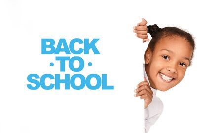 Back to school concept. African-american girl peeking out from empty banner isolated on white
