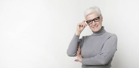 Portrait of confident senior woman wearing glasses, panorama with copy space