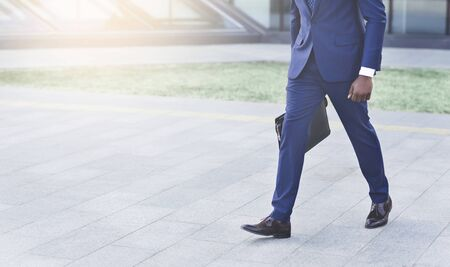 Top Business Manager. Unrecognizable Black Businessman With Briefcase Walking Outdoor In Urban Area.