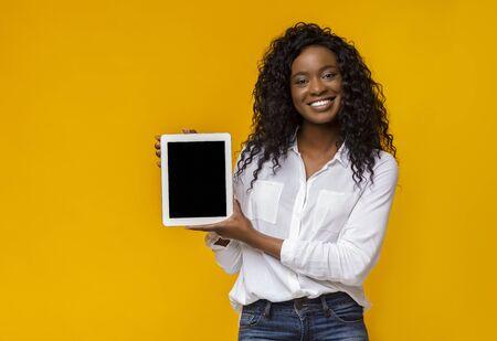 Black Woman Showing Empty Digital Tablet Screen, copy space