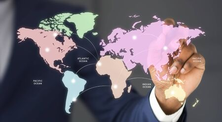 Businessman connecting different countries on world map with arrows, panorama