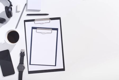 Top view of black and white office supplies with clippers on white background, copy space 写真素材