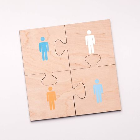 Crowdfunding concept. Puzzle of four pieces with people who connecting for helping, white background