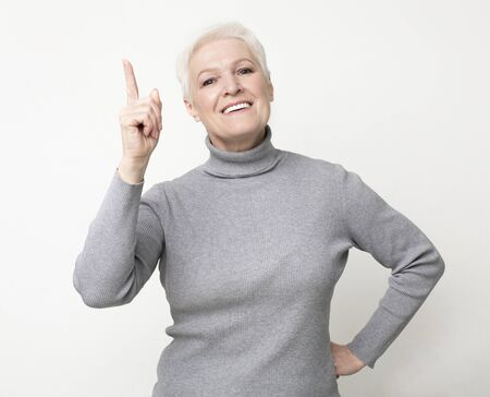 Perfect Idea. Elderly Woman Pointing Finger Up, Got Problem Solution. Stock Photo