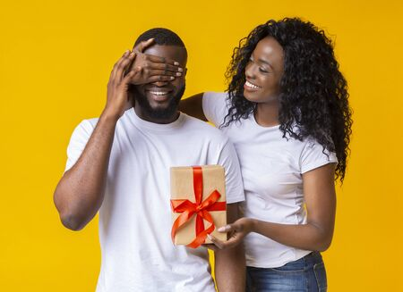 Making gift to boyfreind. African girl with her lover