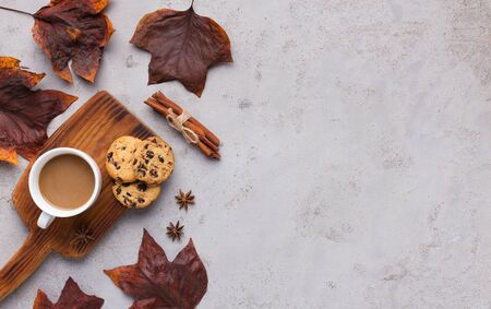 Cozy atmosphere with tasty biscuit and hot coffee on gray background with space for text Stock Photo