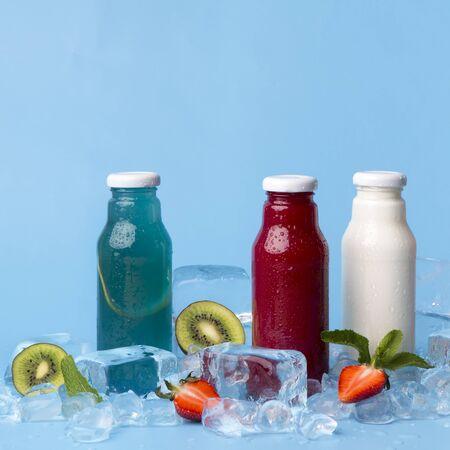 Detox fruit infused flavoured detox cocktails on blue background