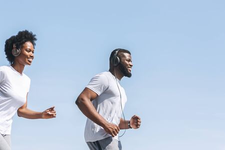 Happy African American Couple Jogging Together Outdoor. Sport And Healthy Lifestyle. Copy Space