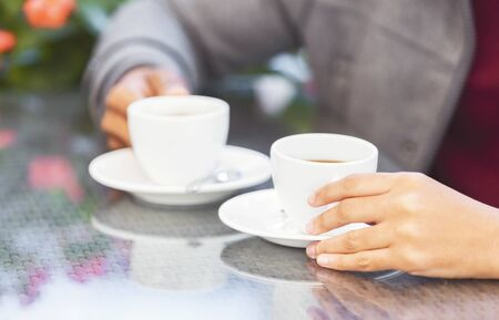Coffee break. Black couple drinking coffee together in cafe, empty space