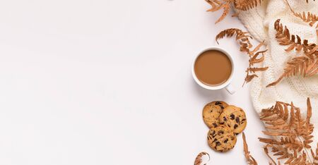 Autumn inspiration and creativity. Dry leaves, biscuits and coffee as frame for advertisement on white  with copy space Stock Photo