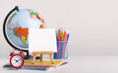 Ready for school. Office stationery with alarm clock on white background, panorama, copy space 写真素材